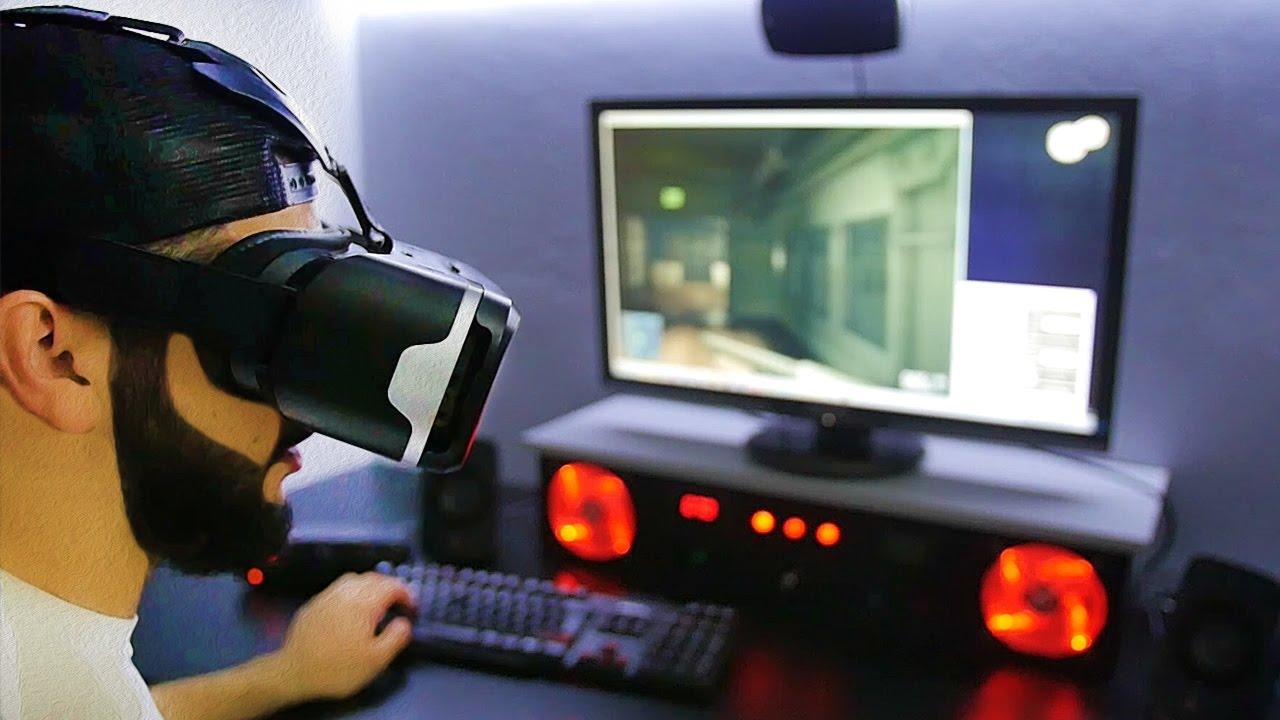 очки виртуальнйо реальности и компьютер.